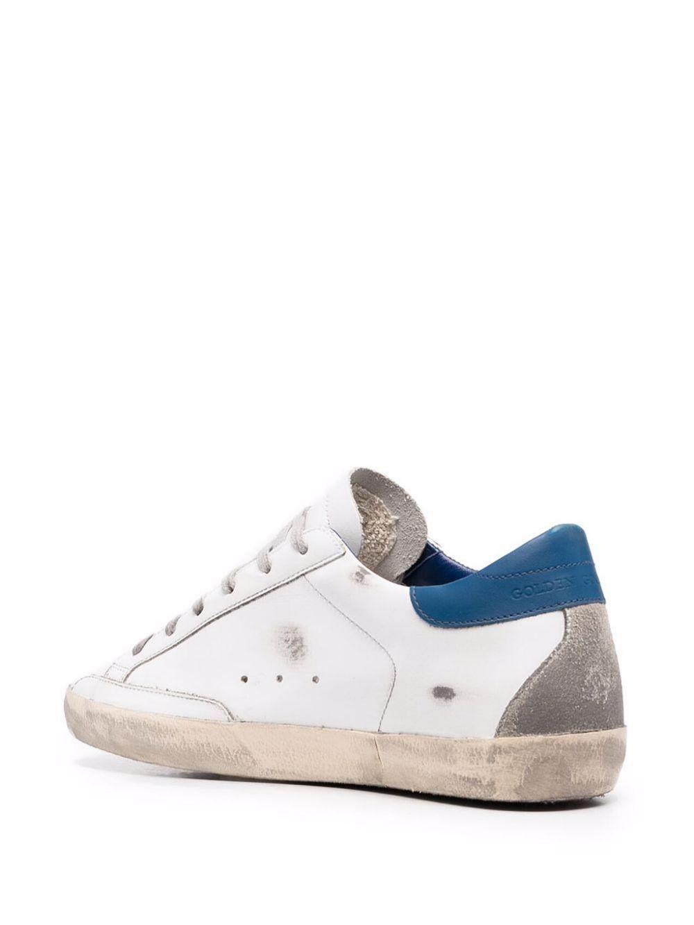 Picture of Golden Goose Deluxe Brand   Superstar Distressed Sneakers