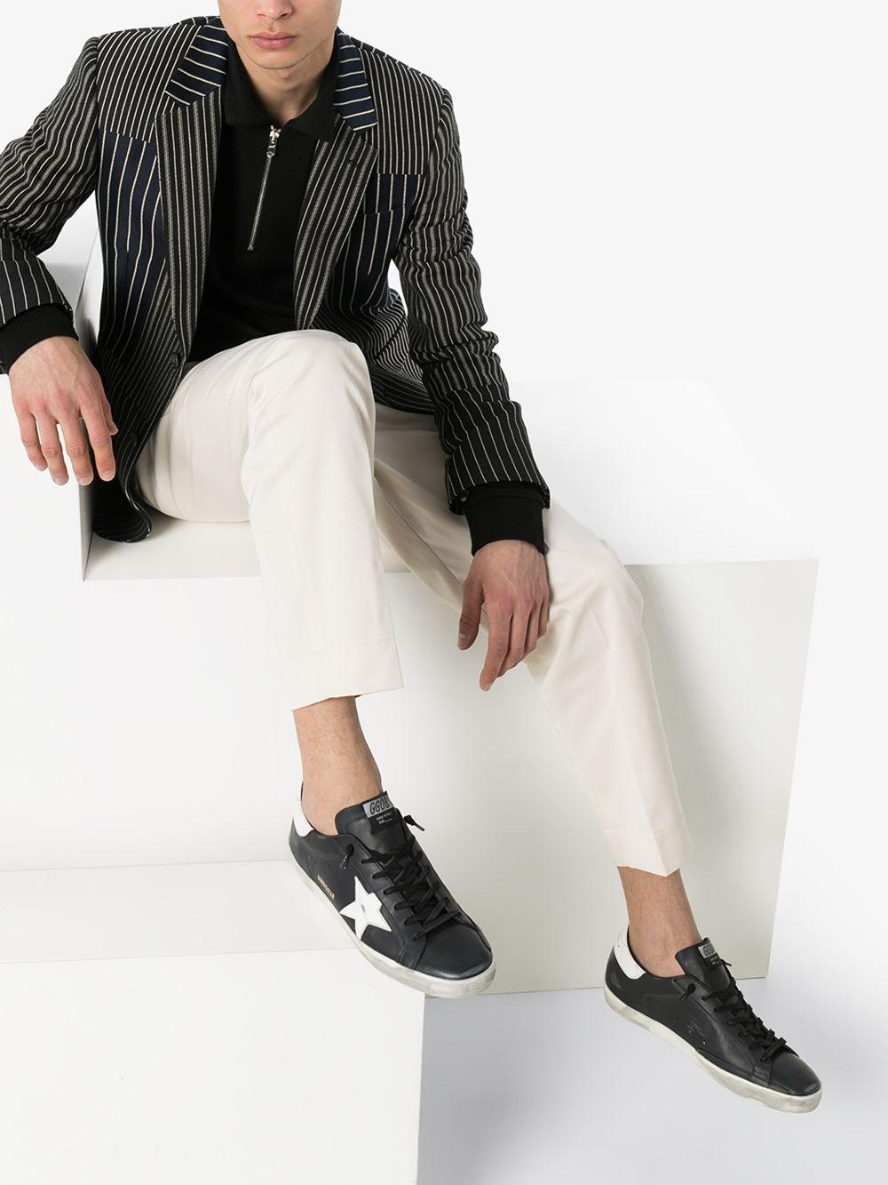 Picture of Golden Goose Deluxe Brand   Superstar Distressed-Effect Sneakers